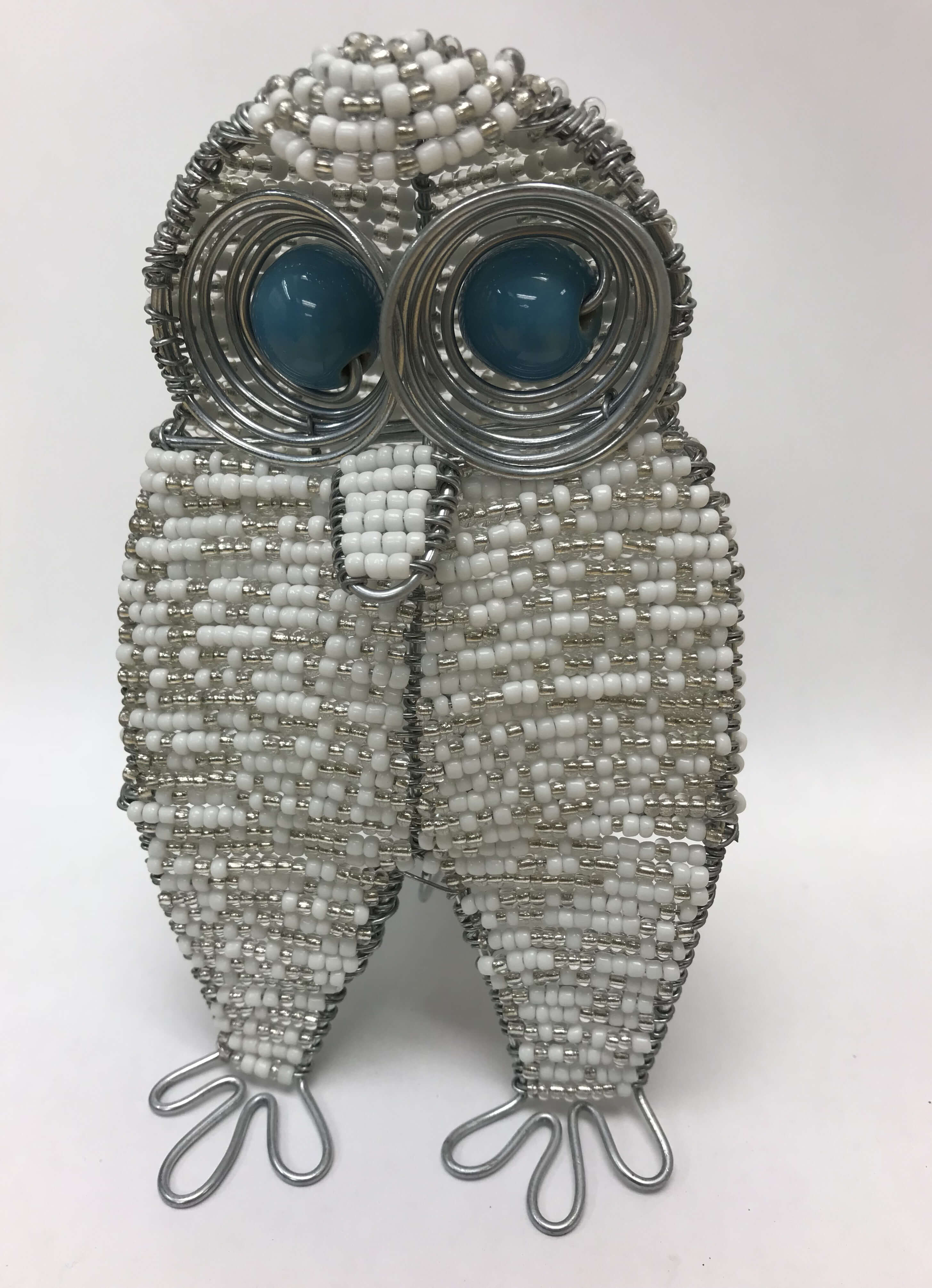 Beaded snowy owl