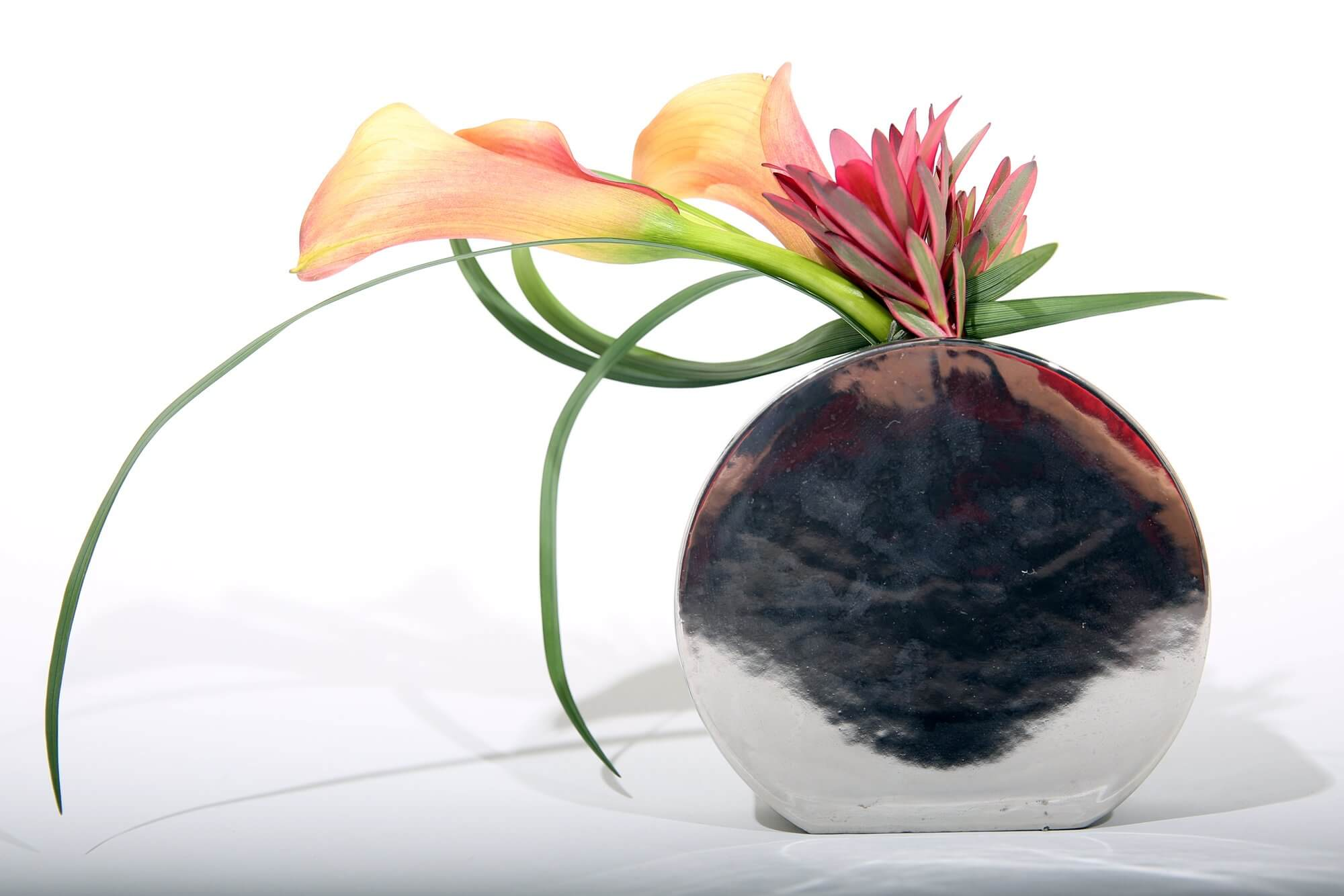 Calla lilly arrangement in silver vase
