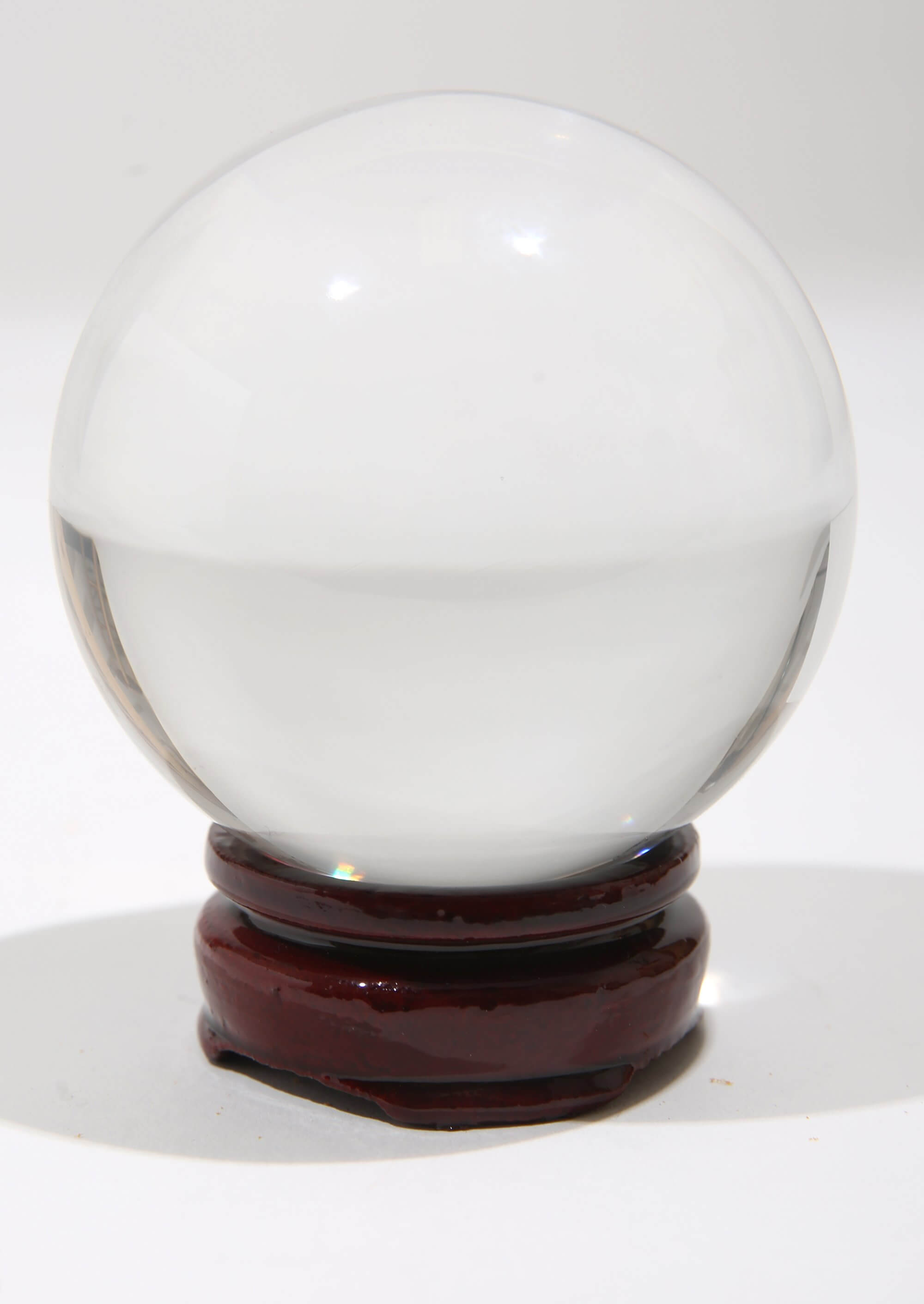 Glass globe on wooden stand
